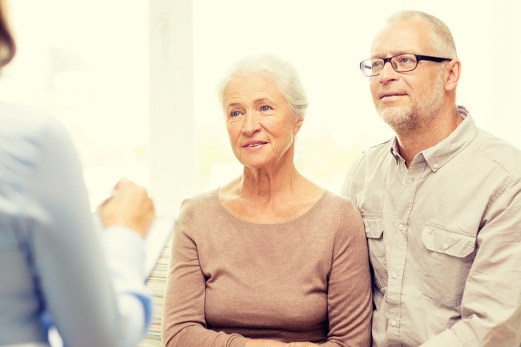 A retired couple preparing for a social security disability benefits interview with their attorney
